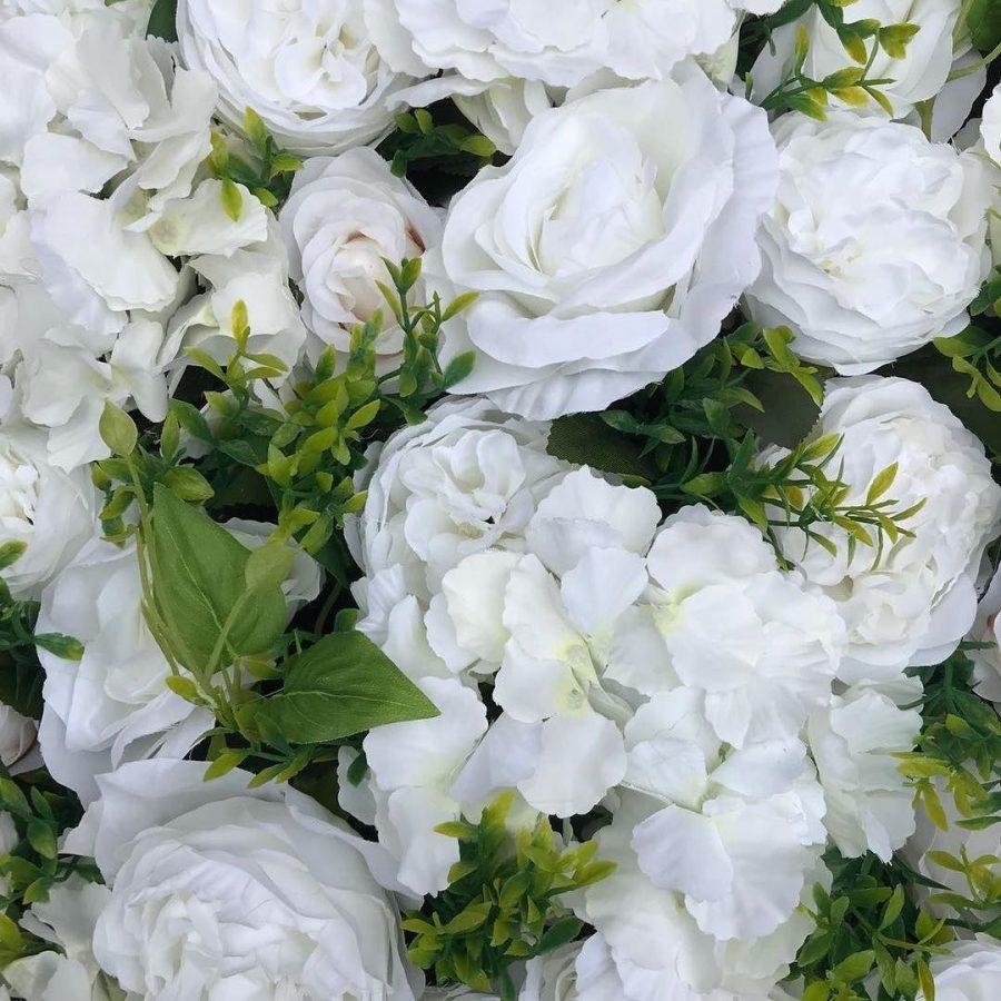 Utleie av blomstervegg til bryllup og selskap.